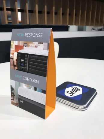 Tent cards and coasters helped introduce the new brand structure.